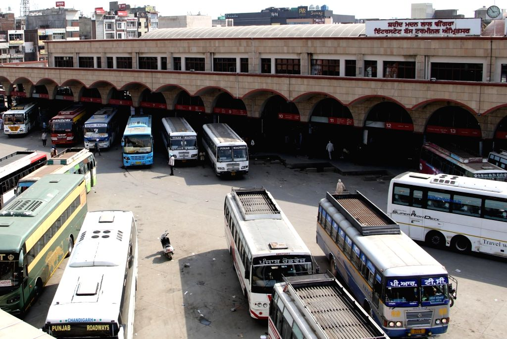 Buses remain parked at a bus depot after public transport services were susupended in the wake of increasing cases of COVID-19, in Amritsar on March 21, 2020.