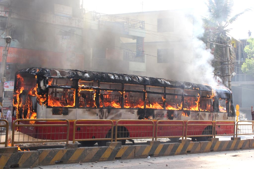 Busses torched during garment factory workers demonstration to protests against amendment in Employees Provident Funds and Miscellaneous Provisions Act, 1952 in Bengaluru, on April 19, ...