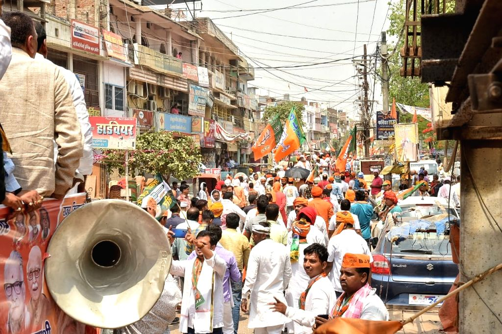 Buxar: BJP workers participate in a roadshow by the party's Lok Sabha candidate from Buxar, Ashwini Kumar Chaubey, ahead of his filing of nomination for the forthcoming Lok Sabha elections, in Bihar's Buxar on April 26, 2019. (Photo: IANS) - Ashwini Kumar Chaubey