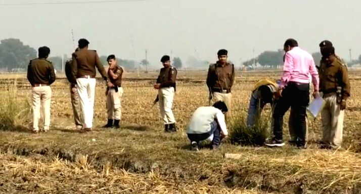 Buxar police personnel inspects the crime scene.