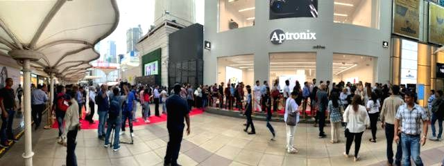 Buyers queue up outside an Apple store after the iPhone 11, iPhone 11 Pro, and iPhone 11 Pro Max smartphones went on sale across both online and offline retail stores in India; at Aptronix in ...