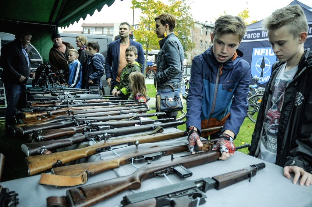 BYDGOSZCZ, Oct. 14, 2017 - Children handle guns on display on NATO Day in Bydgoszcz, Poland, on Oct. 14, 2017. NATO has a training center in the city and offers the public opportunities to visit on ...