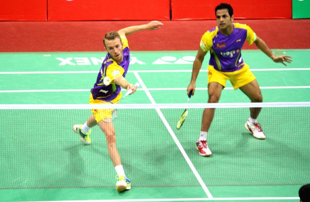 C Mogensen  and A Dewalkar (Banga Beats) beats Mumbai Masters  at IBL -2013 in New Delhi on August 15,2013. (Photo::: Amlan Paliwal/IANS)