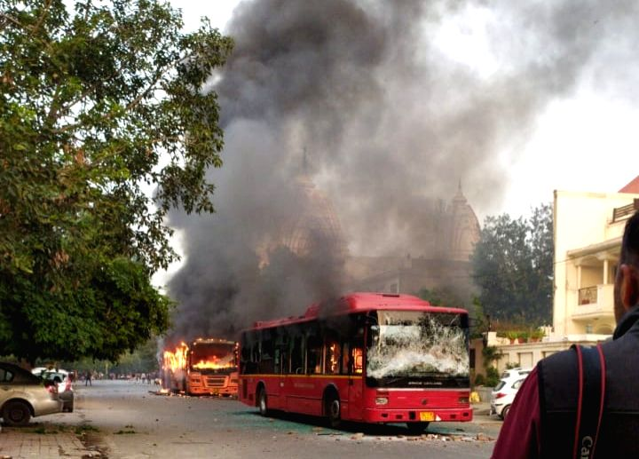 CAA violence claims 4 buses in heart of Delhi, 2 injured.