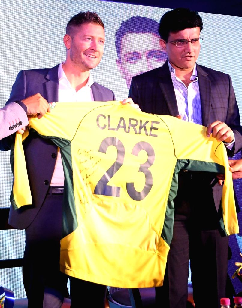 CAB president Saurav Ganguly and former Australia captain Michael Clarke during the launch of Michael Clarke's autobiography 'My Story' in Kolkata on March 14, 2017. - Michael Clarke