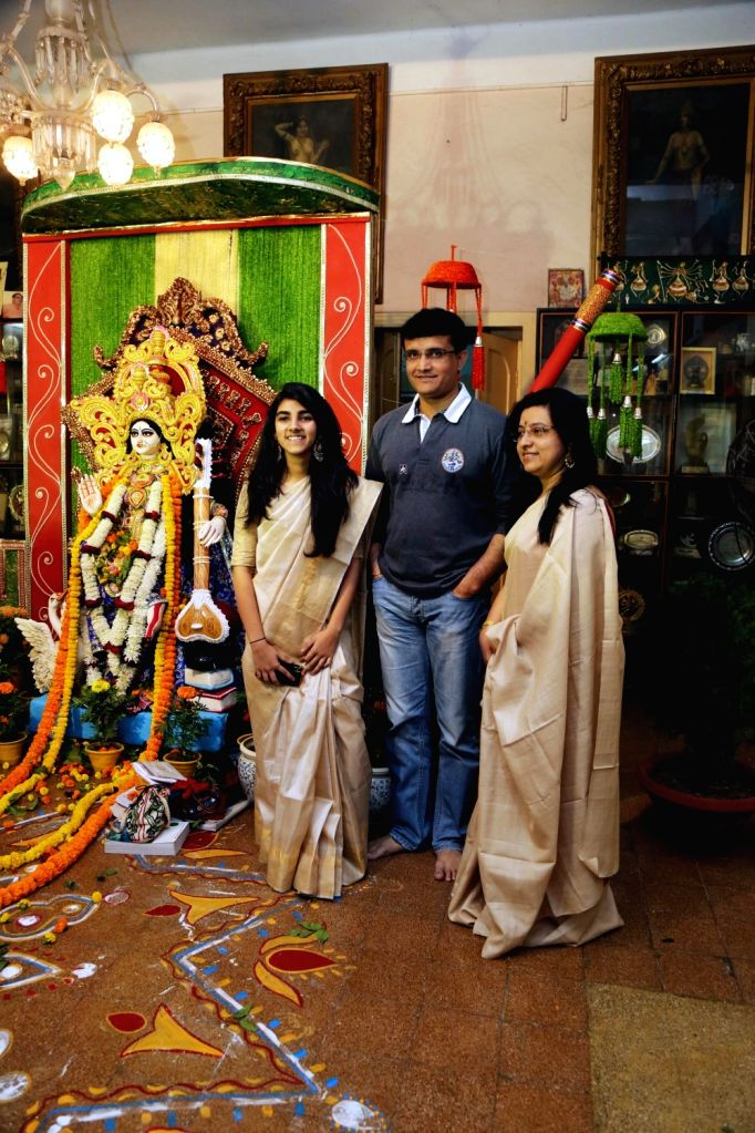 CAB President Sourav Ganguly along with his wife Dona Ganguly and daughter Sana Ganguly during Saraswati Puja celebrations at his residence in Kolkata on Jan 22, 2018. - Sourav Ganguly