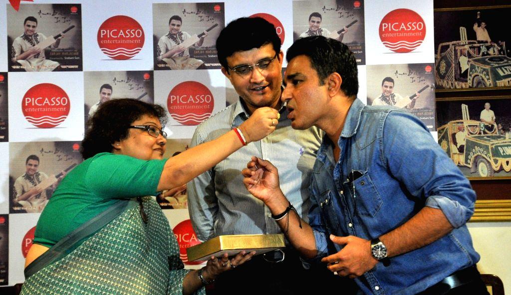 CAB President Sourav Ganguly and former cricketer Sanjay Manjrekar during the launch of Manjrekar's musical album in Kolkata on Oct 4, 2016. - Sourav Ganguly and Sanjay Manjrekar