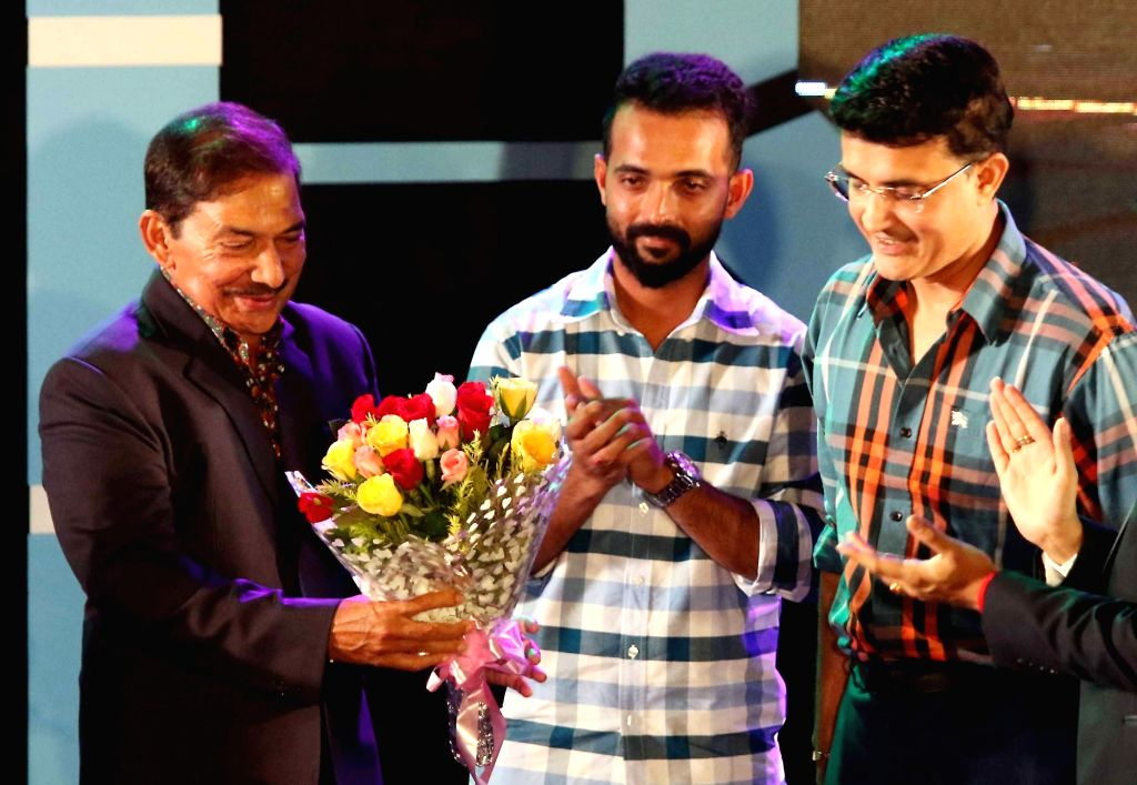 CAB President Sourav Ganguly and former cricketer Arun Lal with cricketer Ajinkya Rahane during CAB's Annual Award Ceremony 2018-2019 in Kolkata on Aug 3, 2019. - Sourav Ganguly