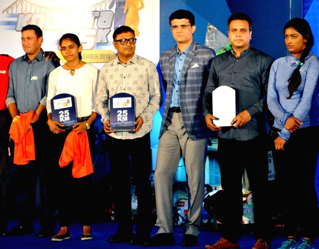 CAB President Sourav Ganguly, former cricketer Ajit Agarkar, Chess Grandmaster Dibyendu Barua, archer Deepika Kumari, and athlete Debashree Mazumdar during Tata 25k press conference in ... - Sourav Ganguly
