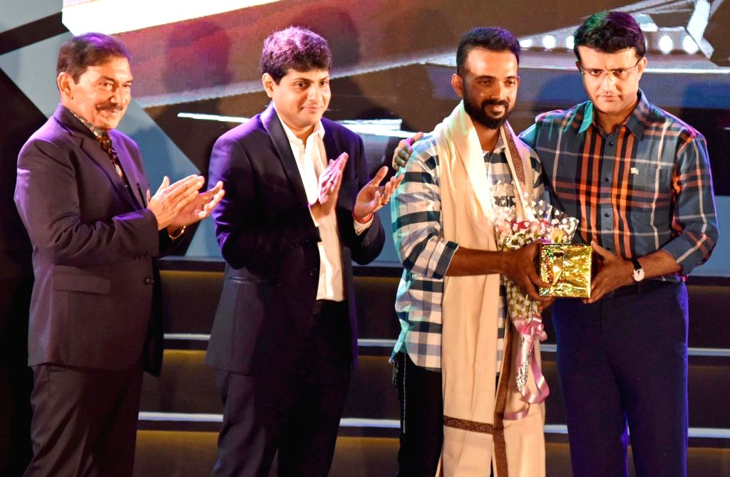 CAB President Sourav Ganguly, Joint Secretary Abhishek Dalmia, former cricketer Arun Lal and cricketer Ajinkya Rahane during CAB's Annual Award Ceremony 2018-2019 in Kolkata on Aug 3, 2019. - Sourav Ganguly