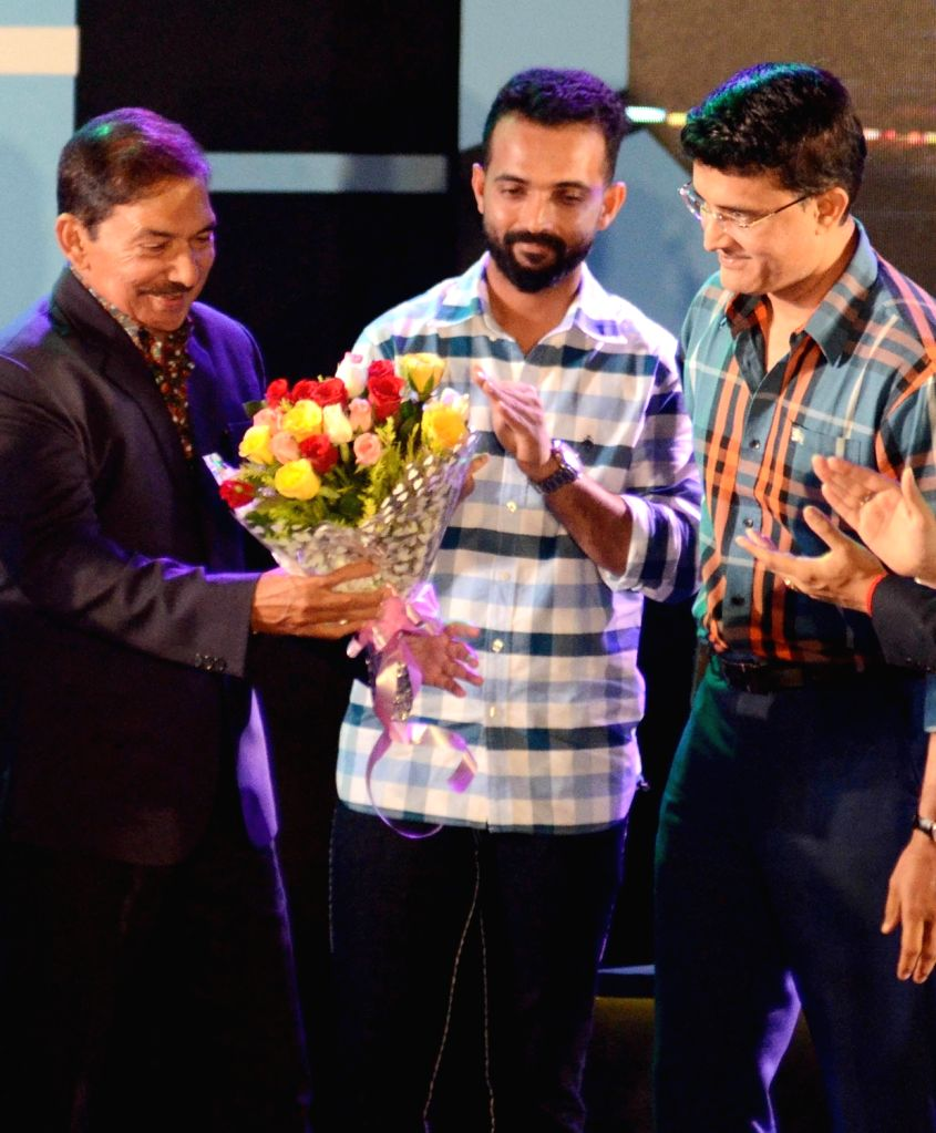 CAB President Sourav Ganguly with cricketer Ajinkya Rahane during CAB's Annual Award Ceremony 2018-2019 in Kolkata on Aug 3, 2019. - Sourav Ganguly