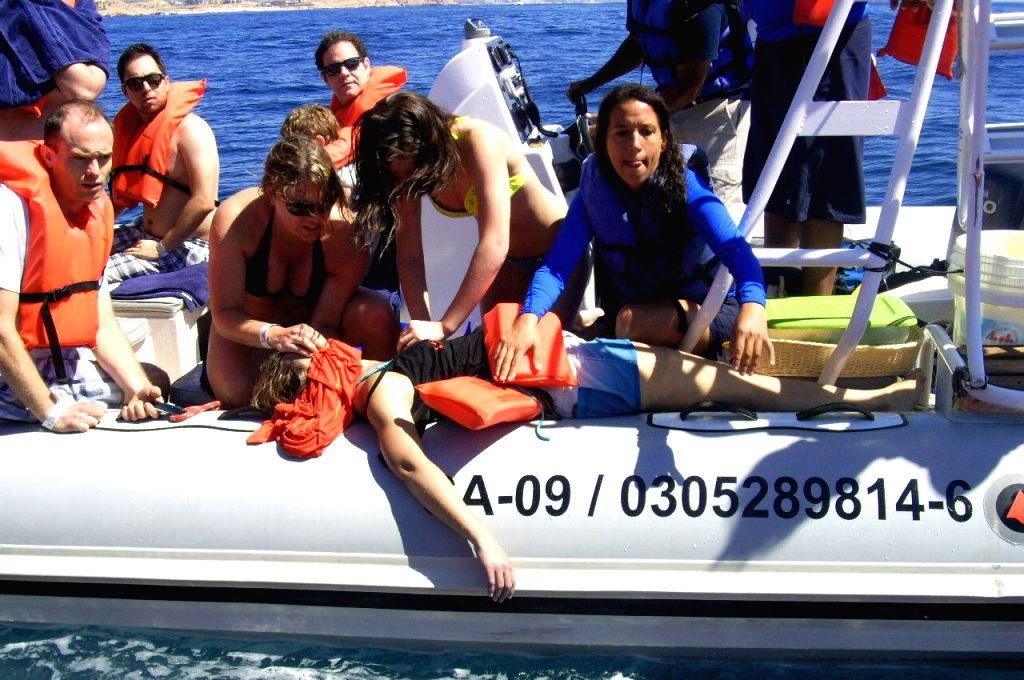 Image provided by Mexico's Federal Attorney for Environmental Protection on March 12, 2015 shows a tourist receiving first aid aboard a boat that collided ...