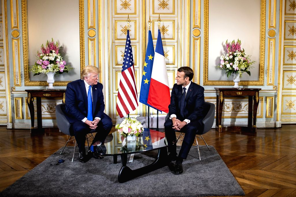 CAEN, June 6, 2019 (Xinhua) -- French President Emmanuel Macron (R) meets with U.S. President Donald Trump in Caen, France, June 6, 2019. Macron on Thursday evoked the spirit of D-Day Landings and the Battle of Normandy to defend global approach and