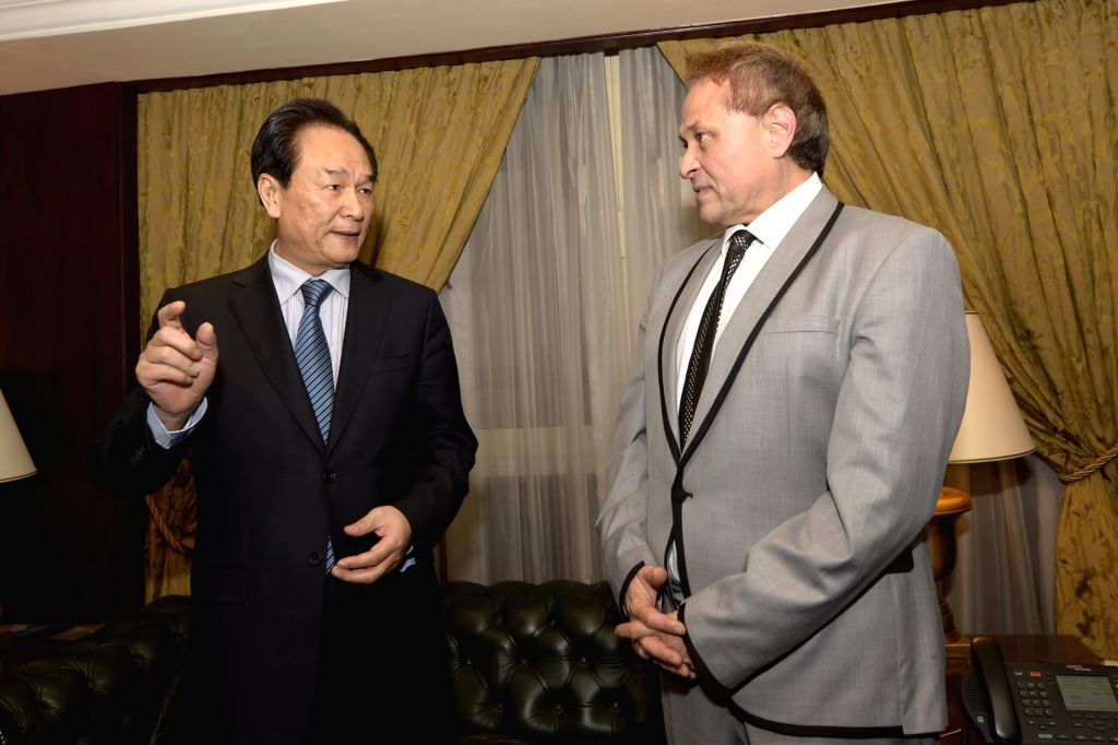 Cai Mingzhao(L), president of China's Xinhua News Agency meets with Alaa Heidar, board chairman and editor in chief of MENA, Egypt official news agency, in Cairo, ...