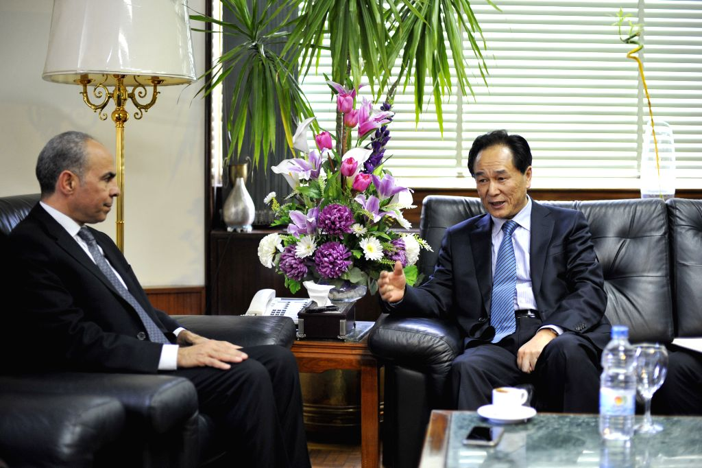 Cai Mingzhao(R), president of China's Xinhua News Agency meets with Ahmed El-Sayed El-Nagger, Chairman of the Board of Al Ahram Foundation in Cairo, Egypt, on Jan. ...