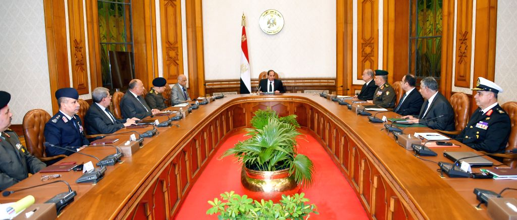 CAIRO, April 10, 2017 - Egyptian President Abdel-Fattah al-Sisi (C) presides over a meeting of the national defense council in Cairo April 9, 2017. Abdel-Fattah al-Sisi on Sunday evening declared a ...