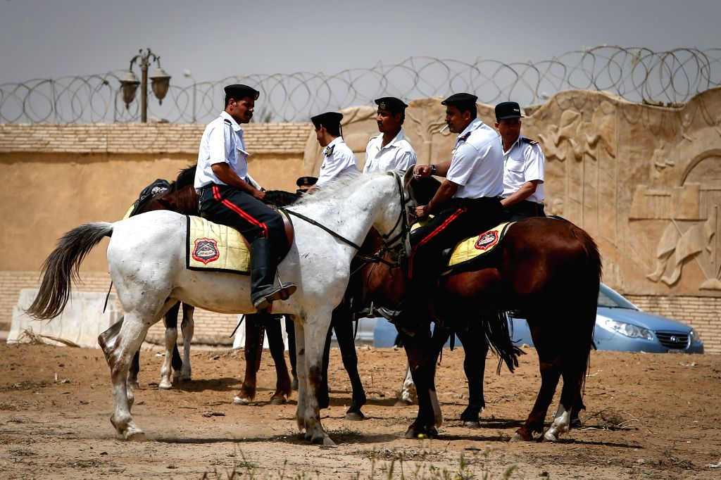 Egyptian police guard the police academy where the Morsi trial takes place in Cairo, Egypt, April 21, 2015. An Egyptian Court on Tuesday sentenced former Islamist ...