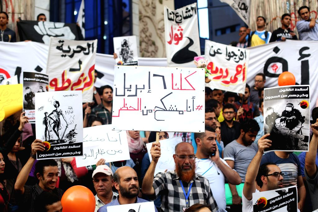 Members of Egypt's April 6 Youth Movement attend a protest against a recent ban on the movement in Cairo, capital of Egypt, on April 30, 2014. An Egyptian court on ..