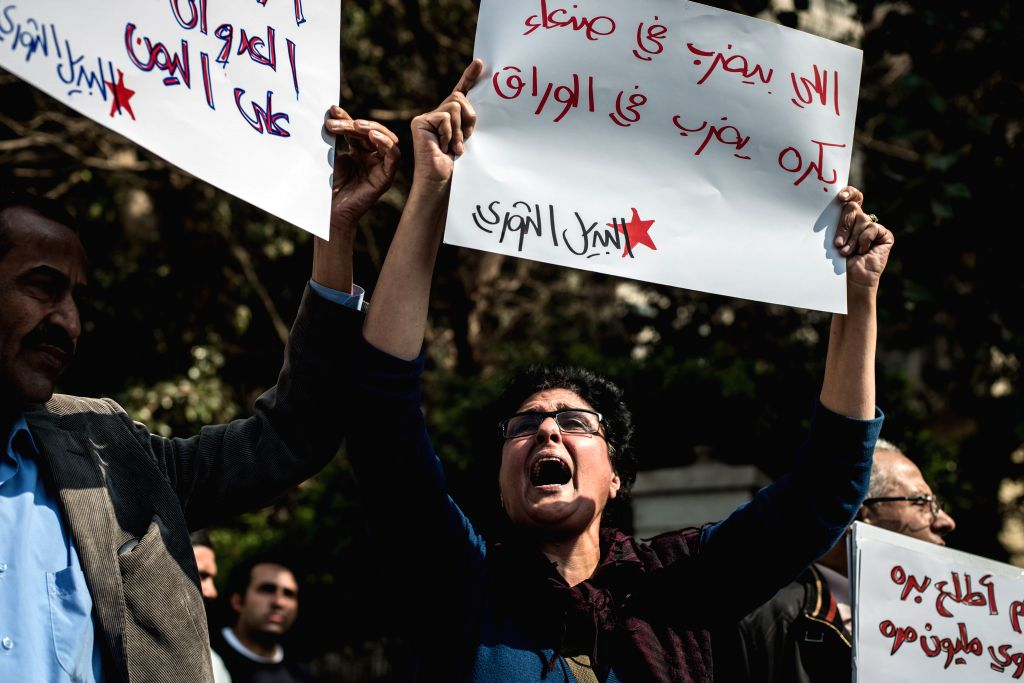 Protesters gather in front of the embassy of Saudi Arabia to protest Saudi Arabia-led airstrikes on Yemen in Cairo, capital of Egypt, April 4, 2015. Around two dozens ...