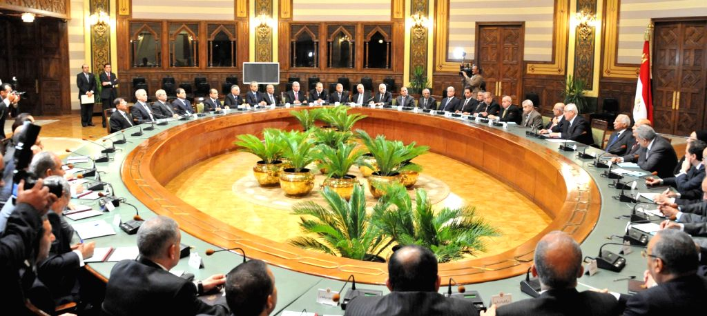A handout picture released by the Egyptian Presidency shows the first meeting of the newly appointed Egyptian Governors in Cairo, Egypt, Aug. 13, 2013. ...