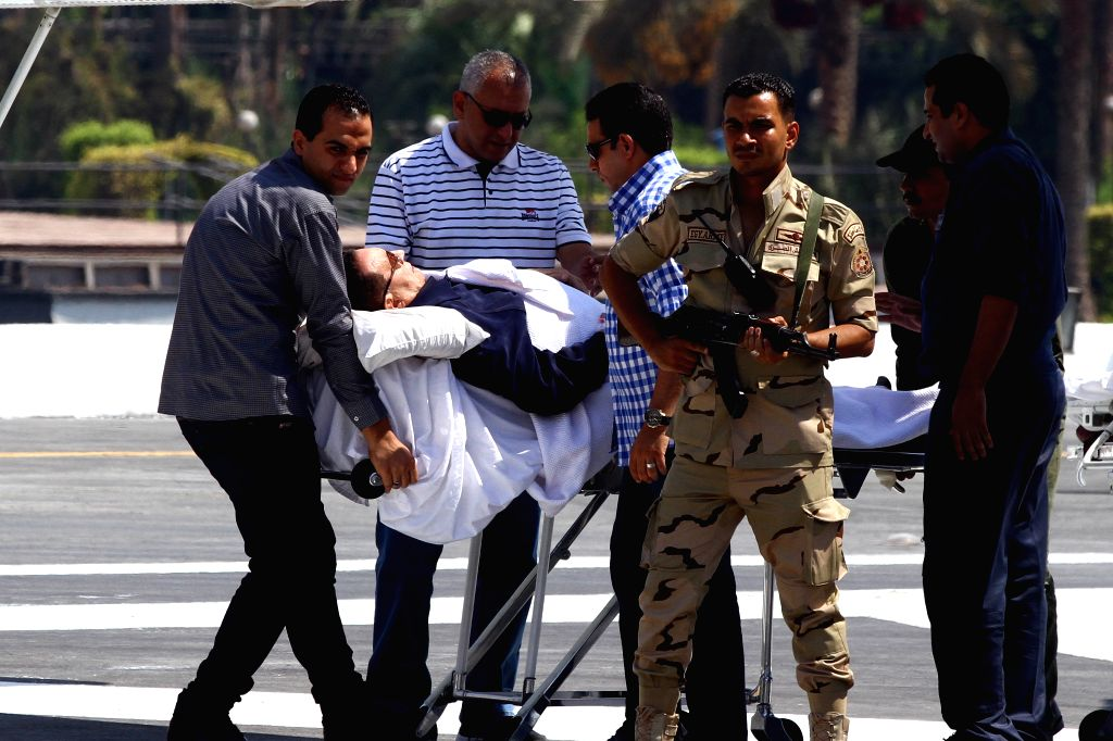 Medical workers carry former Egyptian president Hosni Mubarak from a helicopter to his hospital in Cairo, Egypt,  Aug. 13, 2014. Egyptian former president Hosni ...