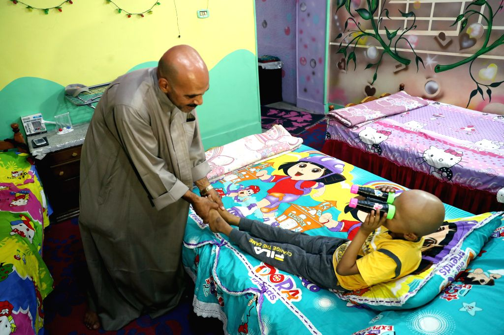 "CAIRO, Aug. 25, 2019 - Siyam Abdo, who runs ""Zaza Home,"" plays with a child at ""Zaza Home"" in Cairo, Egypt, on Aug. 24, 2019. ""Zaza Home"" offers a free rest house for ..."