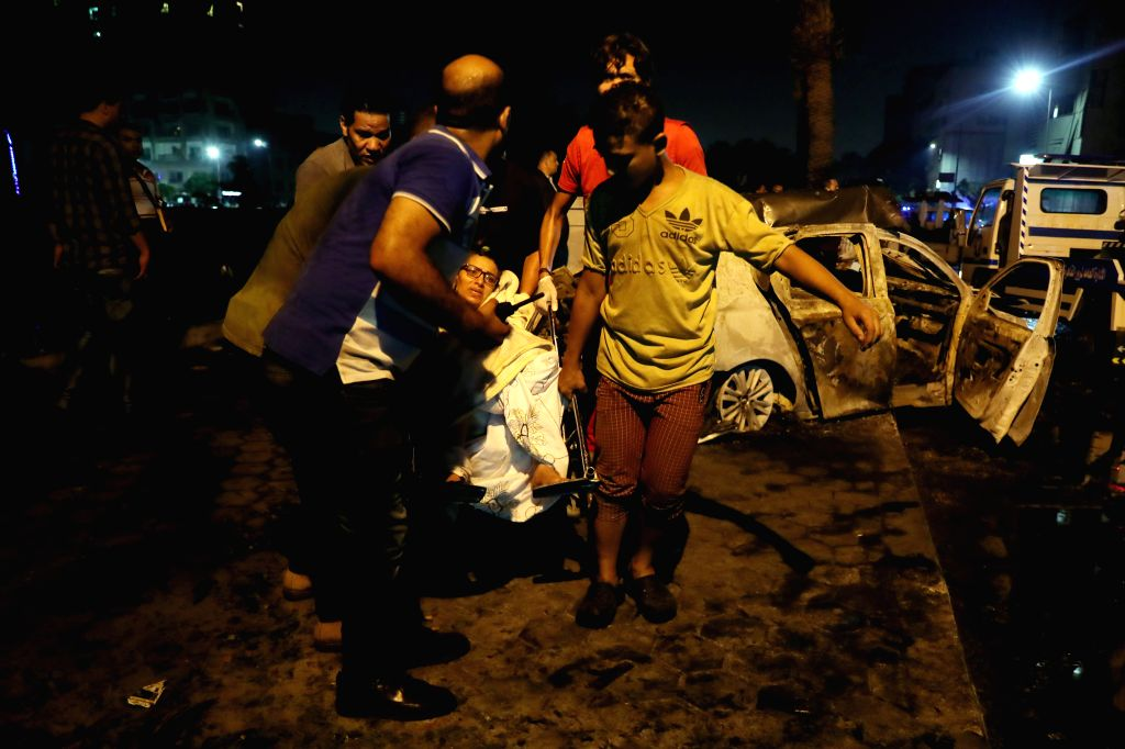 CAIRO, Aug. 5, 2019 - People help an injured woman at the site of an explosion in Cairo, Egypt, Aug. 5, 2019. At least 16 people were killed and 21 others wounded after a multi-vehicle crash and the ...