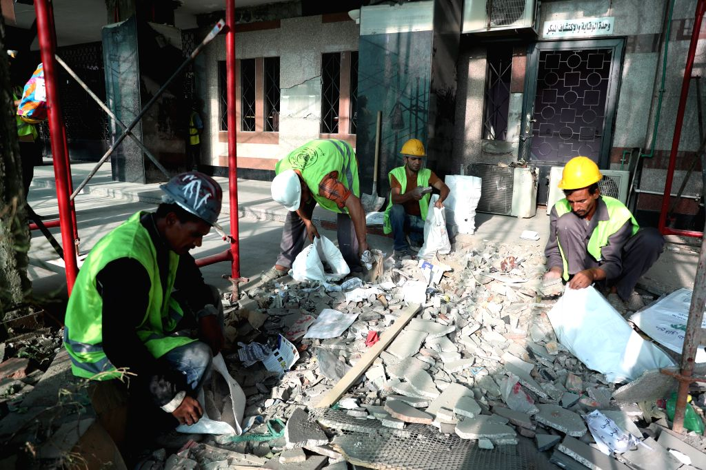 CAIRO, Aug. 9, 2019 - People work at the site of an explosion near the National Cancer Institute in Cairo, Egypt, on Aug. 9, 2019. The Egyptian police on Thursday identified the terrorist who killed ...
