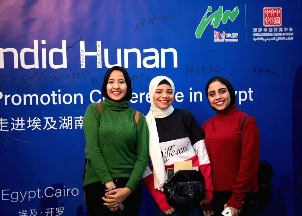CAIRO, Dec. 12, 2019 - People pose for photos during the Splendid Hunan Culture and Tourism Promotion Conference in Cairo, Egypt, on Dec. 12, 2019. The China Cultural Center (CCC) in Cairo held on ...