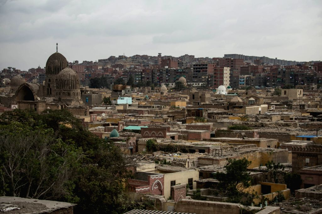 Photo taken along Salah Salem St. shows parts of City of the Dead, a refugee located near Old Cairo, capital of Egypt, on Dec. 12, 2013. City of the Dead, or ...