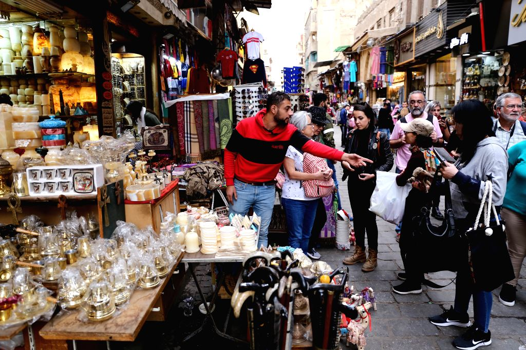 CAIRO, Dec. 14, 2019 - Chinese tourists are seen in the Khan el-Khalili bazaar market in Cairo, Egypt on Dec. 8, 2019. The narrow alleys of Egypt's famous Khan el-Khalili bazaar market in the capital ...
