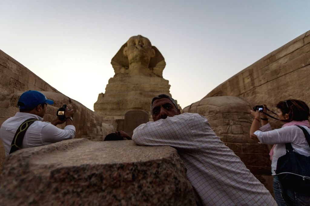 Cairo (Egypt): An Egyptian security guards as journalists take photos in front of the partly renovated Sphinx in Giza, Egypt, on Nov. 9, 2014. Egypt will open to the public the courtyard in front of .