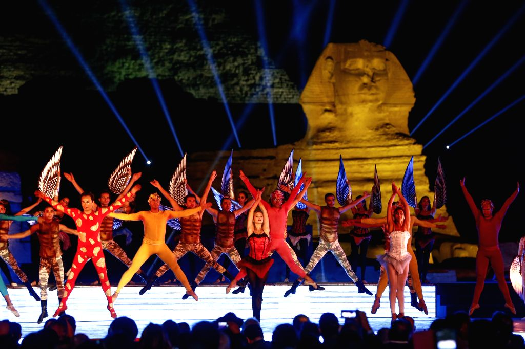 Cairo (Egypt): Dancers perfrom at the closing ceremony of the 36th Cairo International Film Festival (CIFF) at Pyramids plateau in Giza in Cairo, Egypt, on Nov. 18, 2014.
