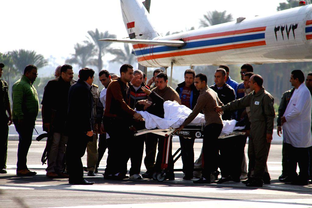 Cairo (Egypt): Egypt's former president Hosni Mubarak(C) leaves Maadi military hospital to the Police Academy in Cairo, Egypt, Nov. 29, 2014. A Cairo criminal court dismissed murder charges against ..