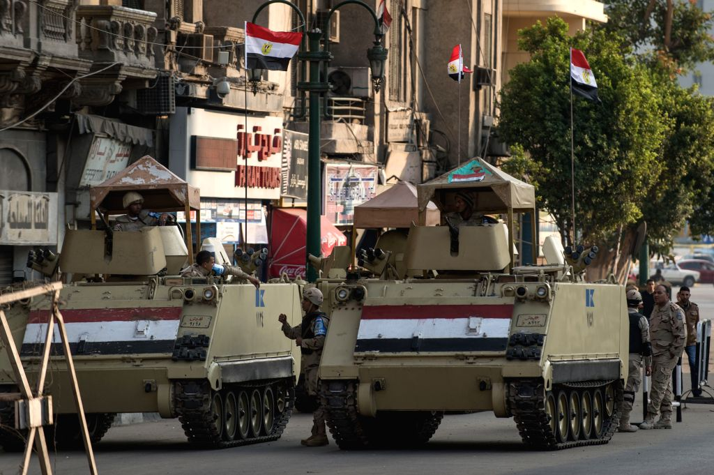 Cairo (Egypt): Egyptian military personnels and tanks guard during a pro-military demonstration at Tahrir Square in Cairo, Egypt, on Nov. 28, 2014. A heavy sound of explosion was heard on Friday ...