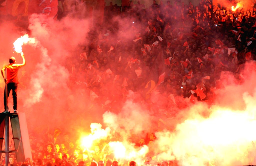 Cairo (Egypt): Fans of Egypt's Al Ahly Sporting Club fire flares for their winning over Sewe Sport of Cote d'Ivoire after the CAF Confederation Cup 2014 final match at Cairo stadium, Egypt, Dec. 6, ..