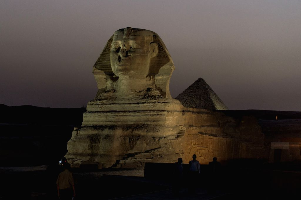 CAIRO (Egypt): Journalists take photos in front of the renovated Sphinx in Giza, Egypt, on Nov. 9, 2014. Egypt will open to the public the courtyard in front of the renovated Sphinx, Egyptian ...