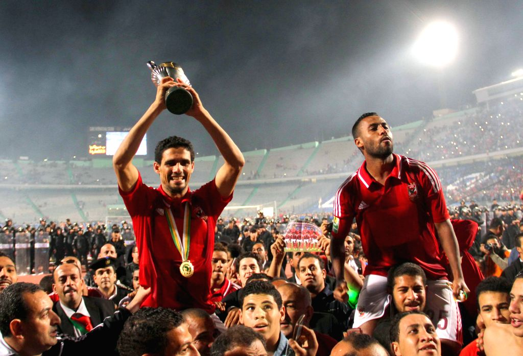 Cairo (Egypt): Players of Egypt's Al Ahly Sporting Club celebrate for their winning over Sewe Sport of Cote d'Ivoire after the CAF Confederation Cup 2014 final match at Cairo stadium, Egypt, Dec. 6, .