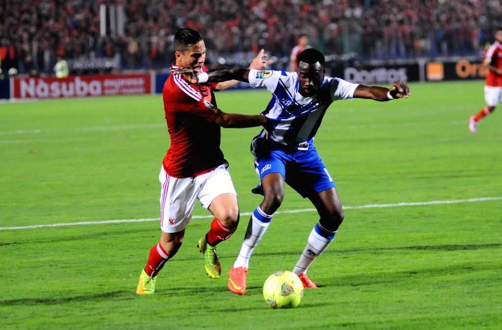 Cairo (Egypt): Ramadan Sobhy (L) of Egypt's Al Ahly Sporting Club fights for the ball with Joseph Kameni of Sewe Sport of Cote d'Ivoire during the CAF Confederation Cup 2014 final match at Cairo ...