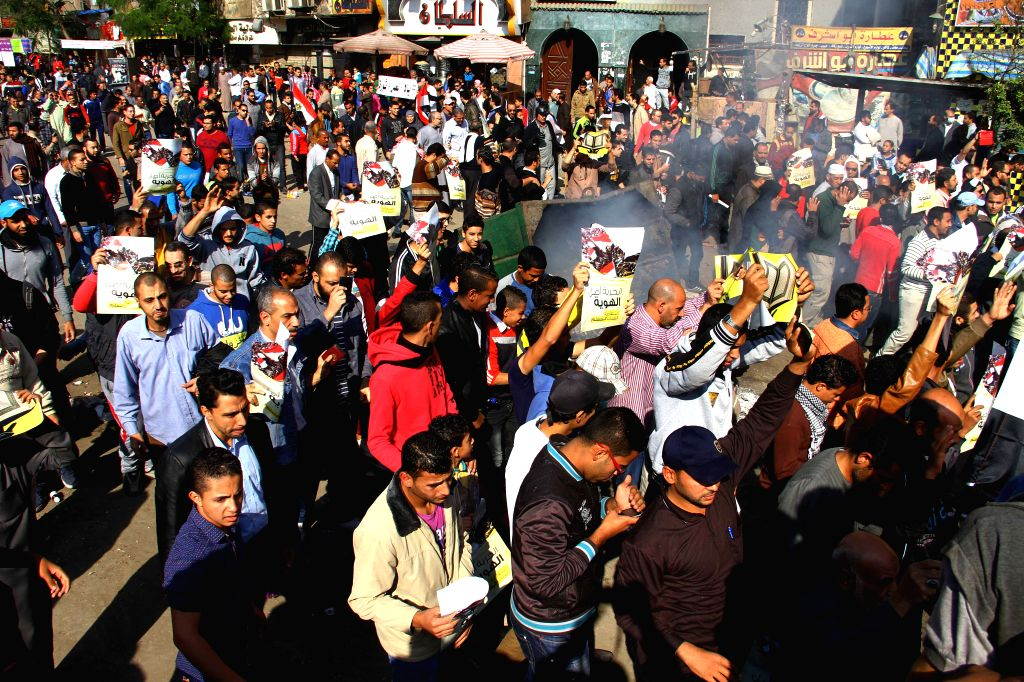 Cairo (Egypt): Supporters of ousted Islamist President Mohamed Morsi attend a demonstration in Cairo's Al Matariyyah district, Egypt, on Nov. 28, 2014. A heavy sound of explosion was heard on Friday .