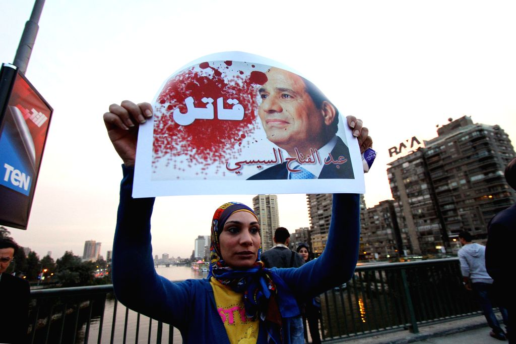 """Egyptian protesters hold banners writing """"Sisi murderer"""" during their protest against state policies and the use of excessive violence to disperse ..."""