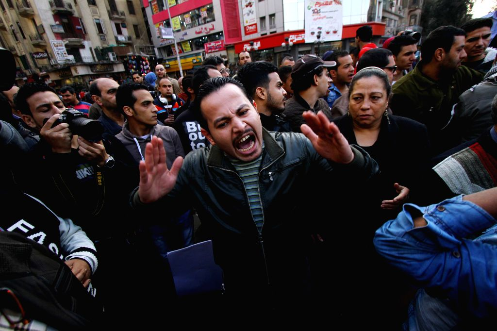 A protestor shouts slogans during a demonstration mourning for the victims purportedly murdered by Islamic State (IS) group militants in Libya, in Cairo, Egypt, on ...