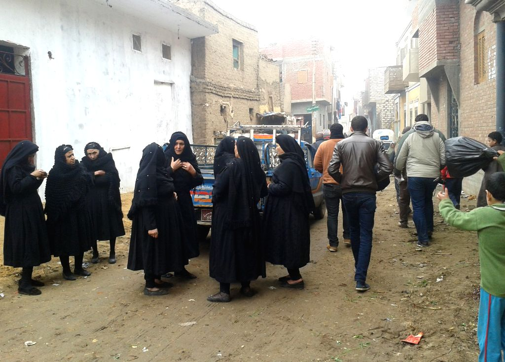 Egyptian women are seen at the village of Al-Awar where Egyptian Coptic Christians mourn the victims purportedly murdered by Islamic State (IS) group militants in ...
