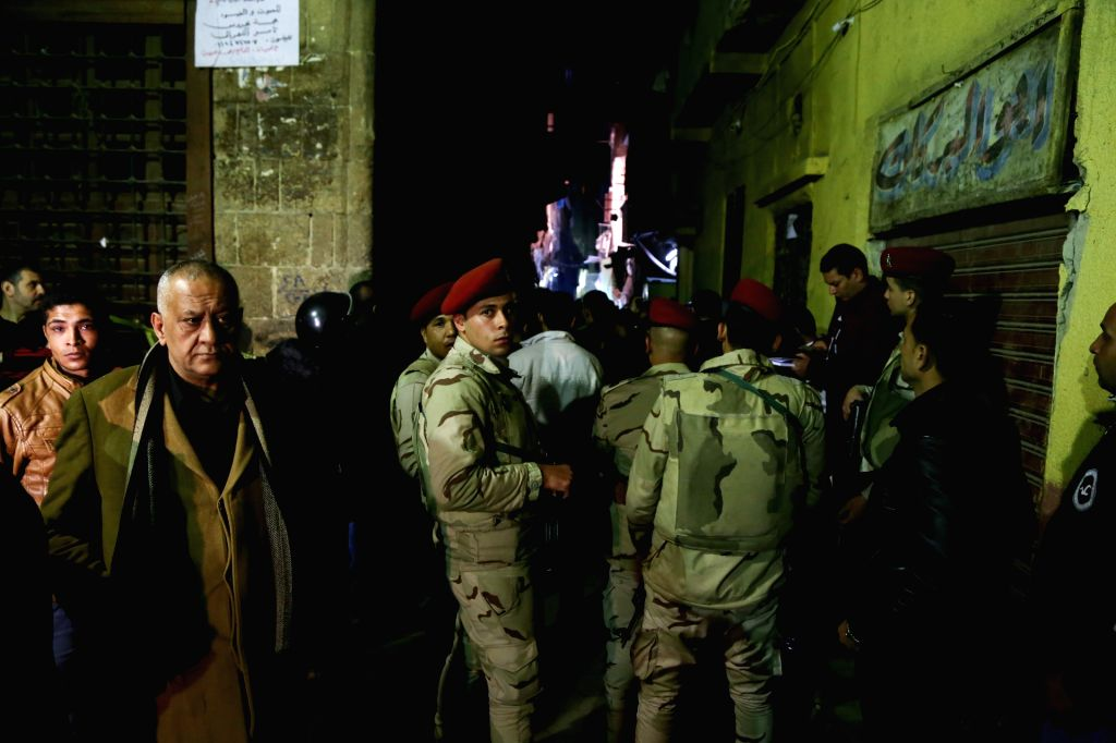 CAIRO, Feb. 19, 2019 - People gather at the site of an explosion in Cairo, Egypt, on Feb. 19, 2019. A terrorist and two Egyptian policemen were killed Monday in a bomb explosion in the old quarter of ...
