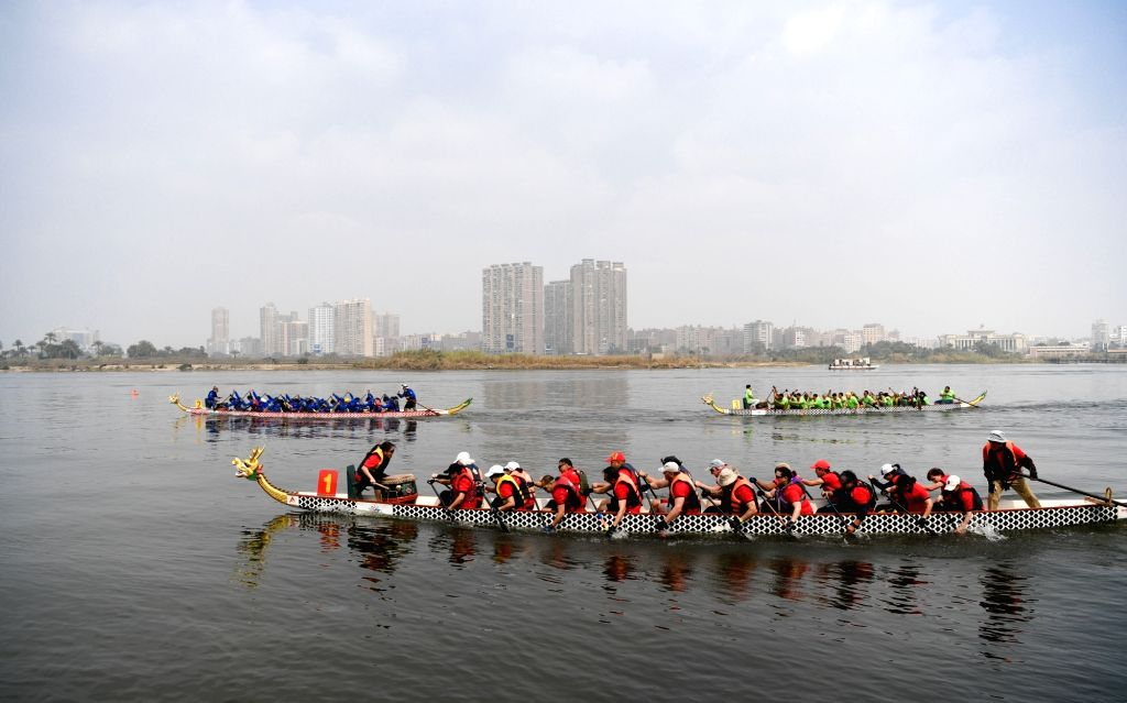 CAIRO, Feb. 23, 2019 - Paddlers compete in the Dragon Boat Race in Cairo, Egypt, on Feb. 23, 2019. The Chinese dragon boat festival was held in Egyptian capital Cairo on Saturday.