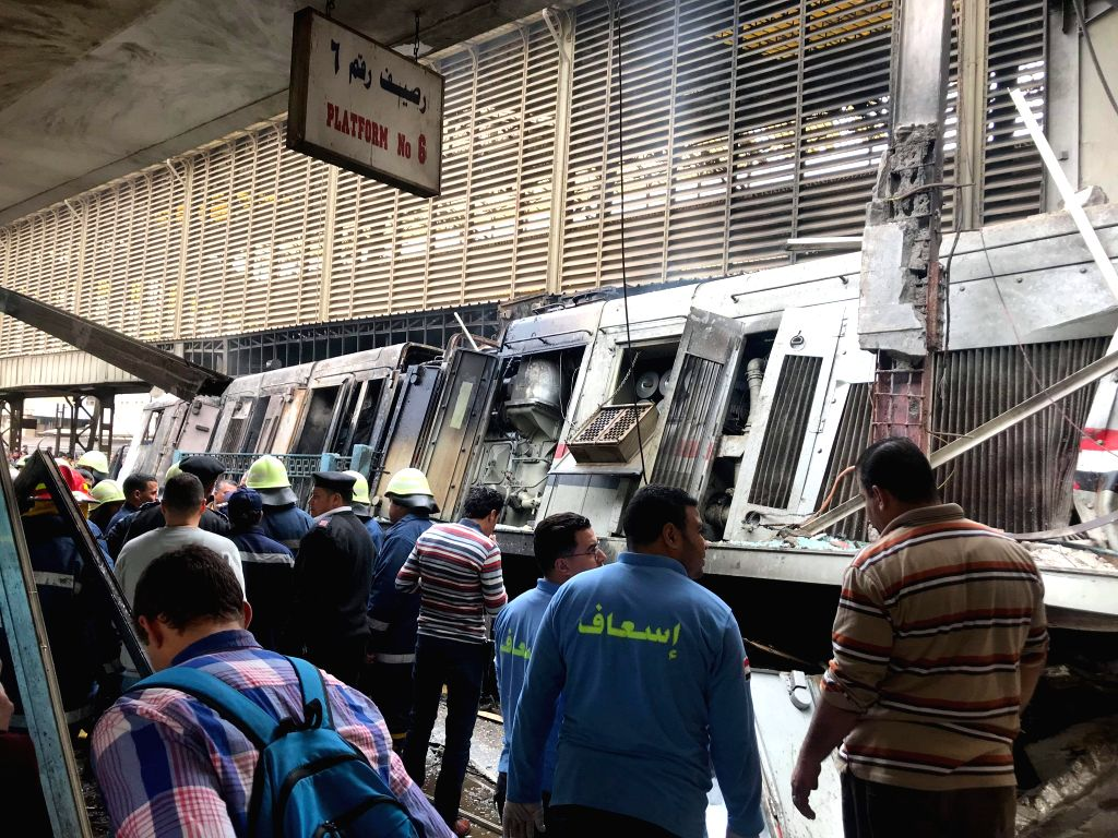 CAIRO, Feb. 27, 2019 (Xinhua) -- Rescuers work at a fire site at a train station in Cairo, Egypt, Feb. 27, 2019. At least 20 people were killed and more than 40 others wounded when a fire erupted inside the main train station in the city center of Eg