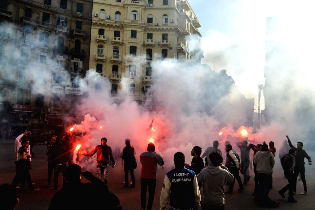 Dozens of protestors use flare during an anti-government demonstration held in downtown Cairo, Egypt, on Jan. 22, 2015, ahead of the fourth anniversary of toppling ...