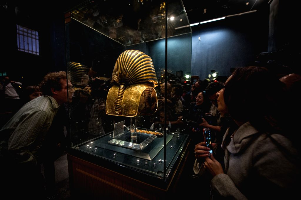 Journalists take photos and video of the displayed Tutankhamun mask in the Egyptian Museum, Cairo, Egypt, on Jan. 24, 2015. Egyptian Ministry of Antiquities held a ...