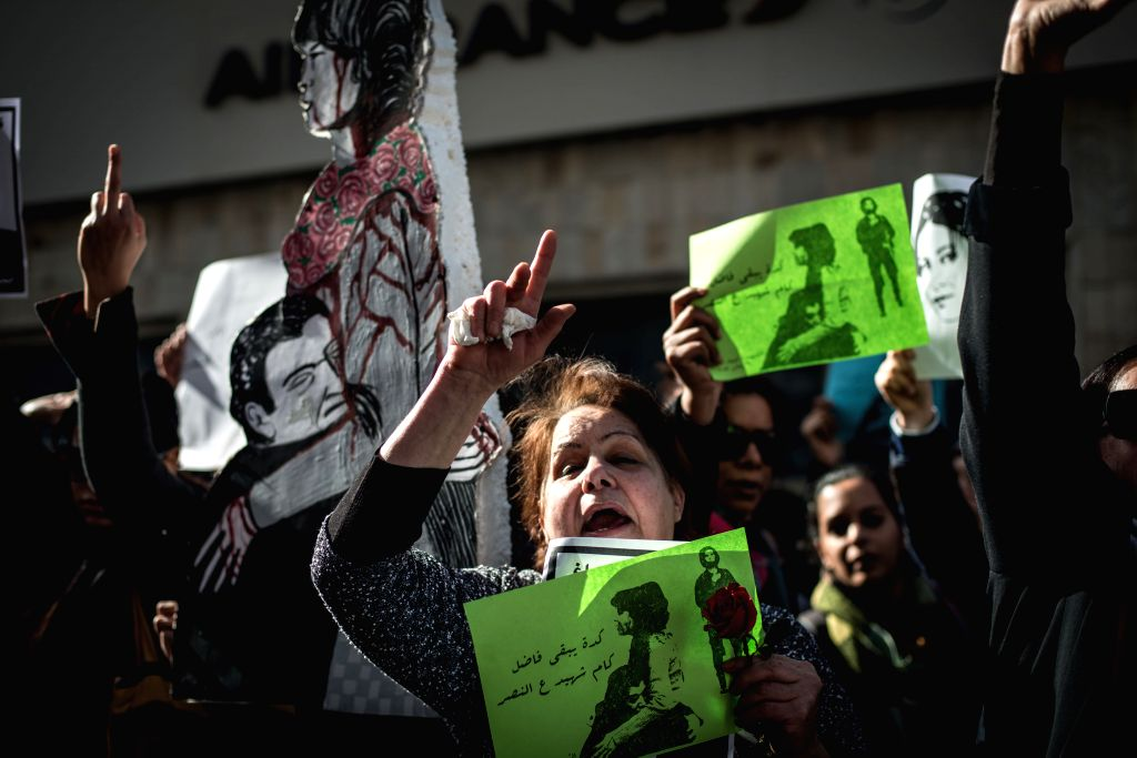 Female protesters hold banners and shout slogans during a demonstration memorizing the female protester, Shaimaa al-Sabbagh, who was shot dead during a protest on the