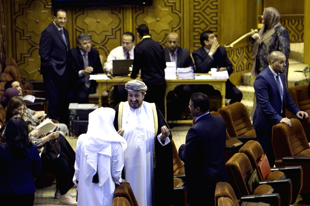 Diplomats of Arab League countries attend the Arab League emergency meeting of Foreign Ministers in Cairo, capital of Egypt, July 14, 2014. Arab Foreign ministers ...